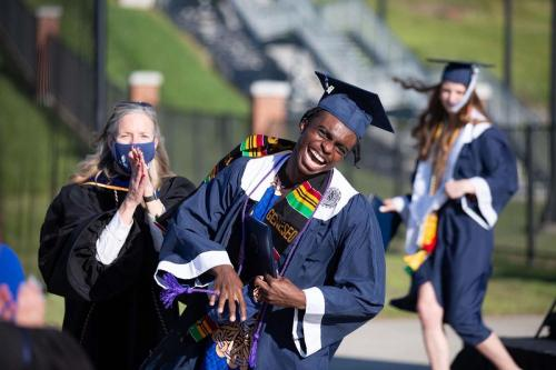 Yaw Mensah '21 celebrates earning his diploma during the May 12 procession and recognition ceremony at the College Stadium. /Photo by Keith Walters '11
